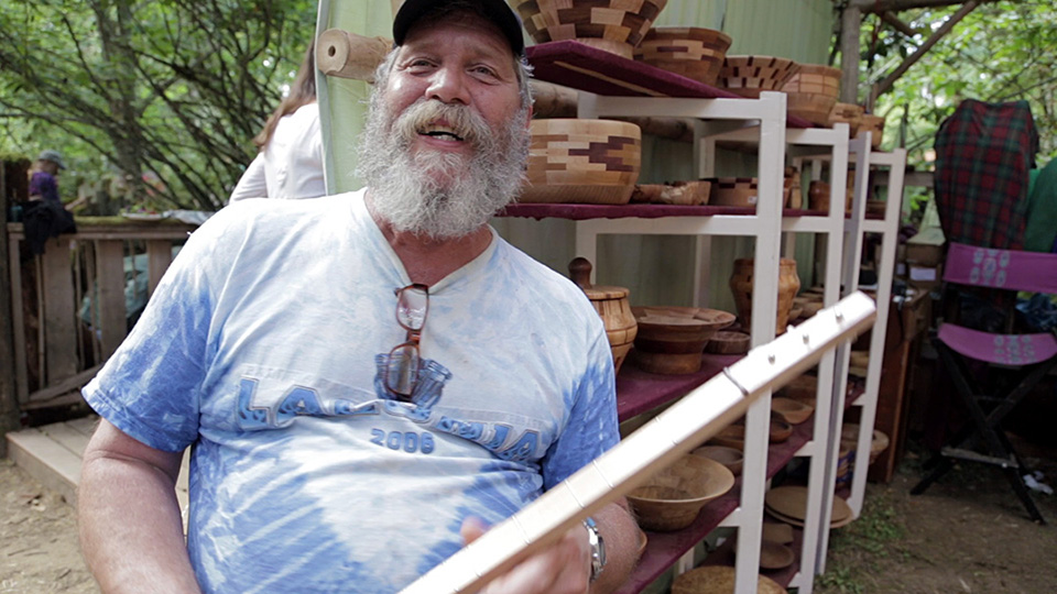 Larry with Wood Turnings and Pickin' Sticks